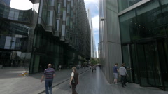 People walking by 7 More London Riverside in London Stock Footage