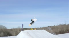 Snowboarder 540 air off of ramp Stock Footage