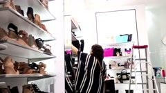 One side of people buying new shoes inside Steve madden shoes store Stock Footage
