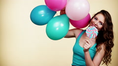 Woman smiling girl with colorful balloons and lollipop 4K Stock Footage