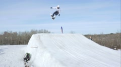 Snowboarder 720 air off of ramp Stock Footage