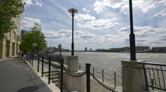 People strolling along River Thames, London Stock Footage