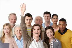 Stock Photo of Group of people, woman with arm raised