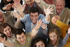 Group of people with arms raised, high angle - stock photo