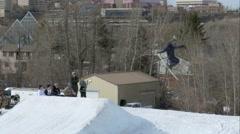 Skier does reverse 180 off jump in Edmonton, Alberta Stock Footage