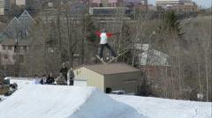 Skier spread eagles off jump in Edmonton, Alberta Stock Footage