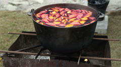 Cast iron pot with mulled wine Stock Footage