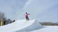 Skier launches off jump in Edmonton, Alberta - stock footage