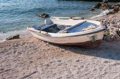 Boat on the beach at Agios Nikolaos port, Zakynthos Stock Photos