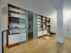 Ligh hall with bookcases Stock Photos