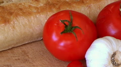 LR Closeup white bread, tomatoes, garlic, cherry tomatoes, mediterranean food Stock Footage