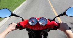 Gauges and mirrors on scooter Stock Photos