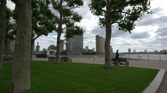 Canary Wharf seen from Westferry Circus's park in London Stock Footage