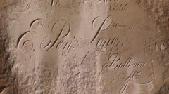 Inscriptions carved on rock Stock Footage