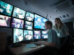 Stock Photo of Students watching screens in forensics training facility