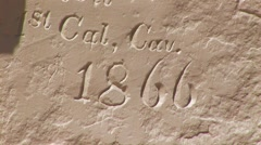 Zoom into historic 17th Century petroglyphs - stock footage