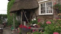 Beautiful cottage restaurant entrance Stock Footage