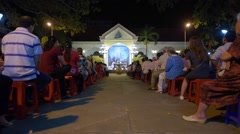 People stand during at night service in the Nha tho Vung Tau Catholic church Stock Footage