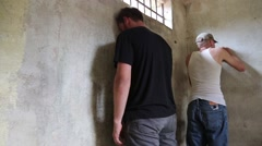 Young Men Bored in Foreign Third World Jail Cell  - stock footage