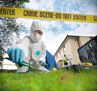 Close up of forensic scientist taking sample at crime scene, surface level view Kuvituskuvat