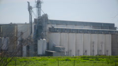 Grain Milling Company In California Central Valley Long Shot Panning Stock Footage
