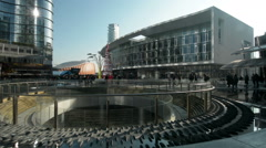 People walking in Porta Nuova, the new business district of Milan, Italy, pan Stock Footage