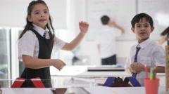 4K Happy group of children in school classroom - portrait of smiling boy & girl. - stock footage