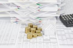 House and step pile of gold coins on finance account Stock Photos