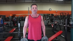 Man Does Dumbbell Curls At The Gym - stock footage