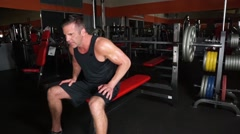Man Gets Pumped Up Before Lifting Heavy Weights Stock Footage