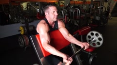 Man Does Preacher Curls At The Gym Stock Footage