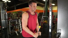 Man Does Tricep Pushdowns At Gym Stock Footage
