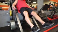 Man Does Squat Machine At Gym - stock footage