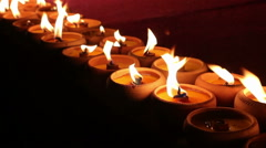 Flame of candle light at night Stock Footage