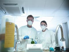 Portrait of forensic scientists dusting for fingerprints in laboratory Stock Photos