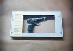 Close up of forensic science evidence box containing gun from crime scene Stock Photos