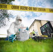 Close up of forensic scientist taking sample at crime scene, surface level view Stock Photos