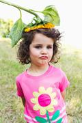 Girl wearing wildflower on her head - stock photo