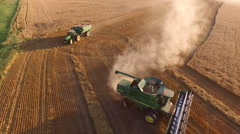 Orbiting Aerial of Combine and Grain Cart during Wheat Harvest (Kansas USA) Stock Footage