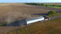 Aerial of Semi Truck Loaded with Grain Leaving the Field during Harvest (Kansas Stock Footage