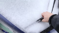 First person view - freeing car's windshield wiper from icy conditions Stock Footage