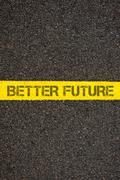 Road marking yellow line with words BETTER FUTURE Stock Photos