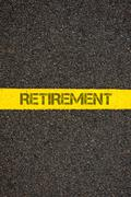 Stock Photo of Road marking yellow line with word RETIREMENT