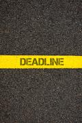 Road marking yellow line with word DEADLINE Stock Photos