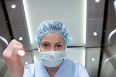 Surgeon shining torch, personal perspective - stock photo