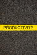 Road marking yellow line with word PRODUCTIVITY Stock Photos
