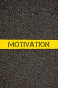 Road marking yellow line with word MOTIVATION - stock photo