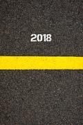 Road marking yellow line year 2018 - stock photo