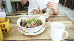 Video Asian girl eating local noodle in Thai restaurant Stock Footage