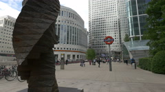 Tourists walking near Canary Wharf station in London Stock Footage